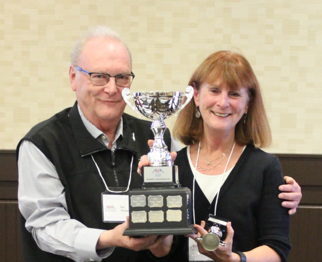 Ron Thompson presenting ARTA Walking Challenge trophy to CRTA Treasurer Linda Manwarren