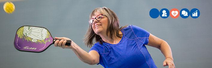 mature woman playing pickleball