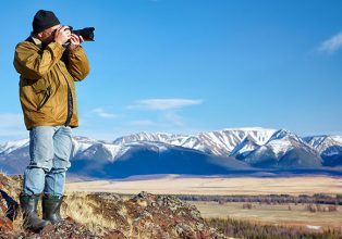 Man taking photo of mountains