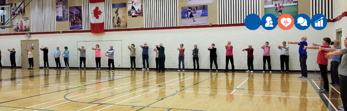 retirees stretching in a gym